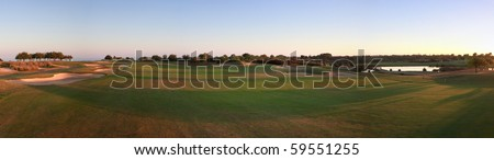 Panoramic picture of a golf course.