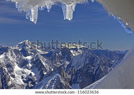 Panoramic picture of Mont Blanc, french Alps,Chamonix. With 4808 meters its the highest alpine peak, seen from the Aiguille du Midi cable car station (3842 m). - stock photo