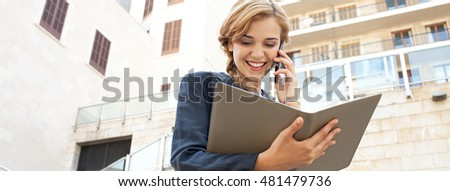 Panoramic portrait of beautiful business woman using smart phone in classic financial city, speaking phone call conversation, smiling outdoors. Professional girl using technology, lifestyle exterior.
