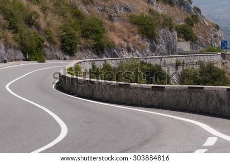 panoramic road curve - stock photo