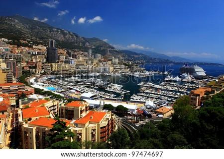 panoramic scenery of bay of Monaco with blue sky - stock photo