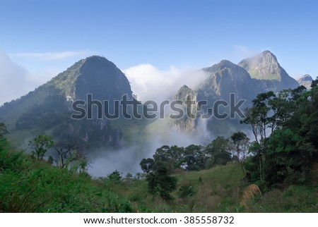 Panoramic scenery of the mist shrouded mountains
