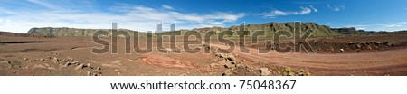 Panoramic scenic view of road on volcanic landscape of the Plaine des Sables, Reunion Island
