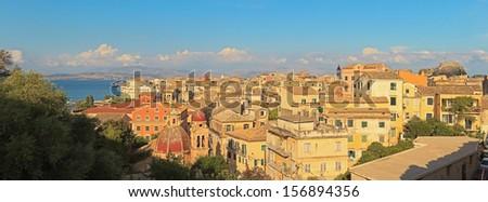 Panoramic shot of Corfu city with blue cloudy sky. Sen from above. Kerkyra. Corfu island. Greece. - stock photo