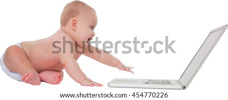Panoramic shot of cute baby boy using laptop computer Full length of toddler is sitting with wireless technology He is isolated over white background - stock photo