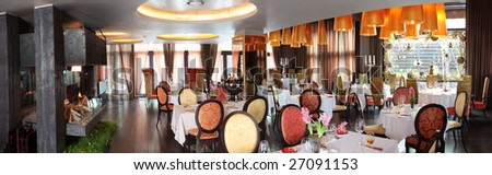 panoramic shot of luxury sitting room and table in 5 star restaurant - stock photo