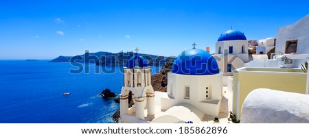 Panoramic shot of the Blue domed church at Oia Santorini Greece Europe - stock photo