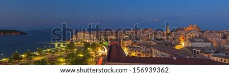 Panoramic shot of the citylights of Corfu city at night. Kerkyra. Corfu island. Greece. - stock photo