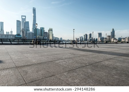 panoramic skyline of shanghai with empty street floor - stock photo