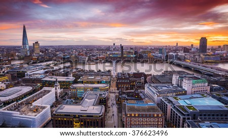 Panoramic skyline shot of south London at dusk with beautiful sunset and red clouds and famous skyscrapers and landmarks - London, UK - stock photo