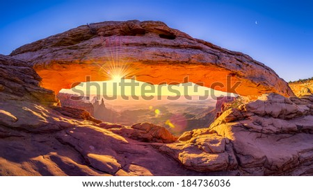 Panoramic sunrise at iconic Mesa Arch  in Canyonlands National Park, Utah - stock photo