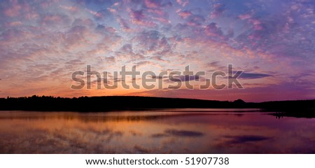 panoramic sunset above the lake with bright colors go very well for site header - stock photo