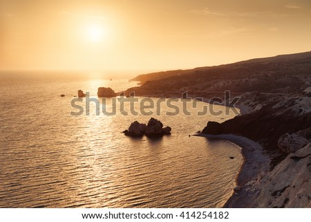 Panoramic sunset landscape of Petra tou Romiou (The rock of the Greek), Aphrodite's legendary birthplace in Paphos, Cyprus island, Mediterranean Sea.  - stock photo
