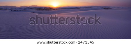 Panoramic sunset of the White Sands National Monument, New Mexico, USA. - stock photo