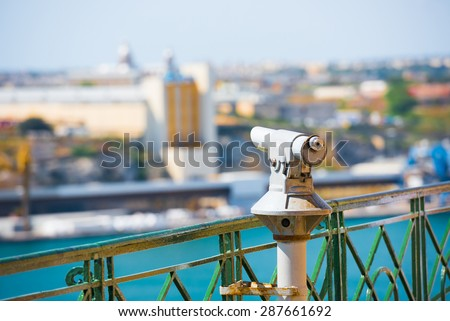 panoramic telescope for viewing distanced city attractions - stock photo