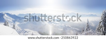 Panoramic view across the Alps from the top of Le Ranfoilly in the Portes du Soleil ski area. - stock photo