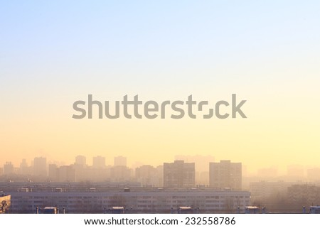 Panoramic view at city at misty morning sunrise - stock photo