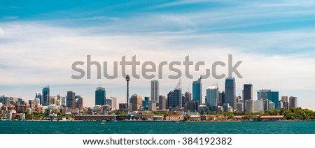 Panoramic view at Sydney city urban skyline from Western Plains with blue sky and clouds on a bright day - stock photo