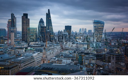 Panoramic view City of London at sunset. River Thames and London bridge - stock photo