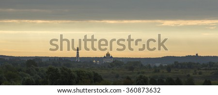 Panoramic view .Domes of the church and bell tower visible on the horizon.
