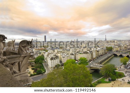 panoramic view from balcony of Notre Dame de Paris with famous gargoyles at sunset - stock photo
