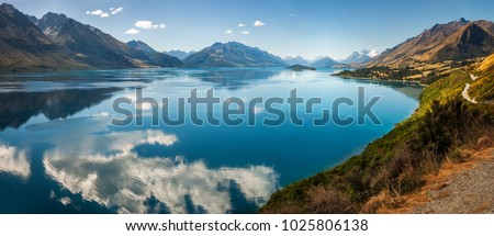 Panoramic view from Bennett's Bluff Lookout on one of the most scenic drives in New Zealand that connects Queenstown and Glenorchy and overlooks Pig and Pigeon Islands and Lake Wakatipu.