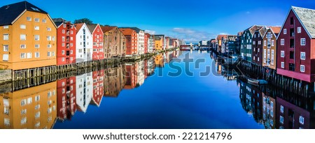 Panoramic view from bridge to famous wooden colored houses in Trondheim city, Norway - architecture background - stock photo