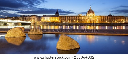 Panoramic view from Rhone river in Lyon city by night, France. - stock photo
