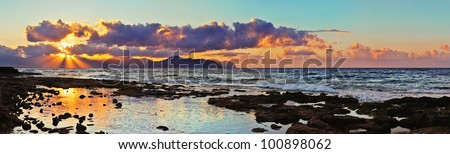 Panoramic view from the coast of Aspra (Sicily). In the distance one can see the coast of Palermo. - stock photo
