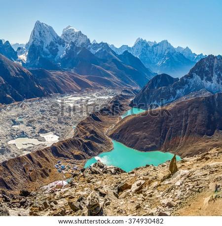 Panoramic view from the Gokyo Ri (5357 m) to the Ngozumba glacier, village, and the third lake (Dudh Pokhari) - Gokyo region, Nepal, Himalayas - stock photo