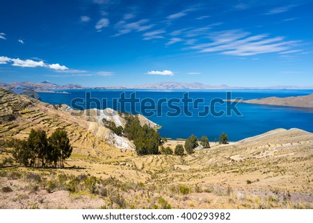Panoramic view from the Island of the Sun towards the Yampupata Peninsula on the majestic Titicaca Lake, among the most scenic travel destination in Bolivia. - stock photo