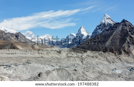 Panoramic view Gokyo Glacier, Everest, Lhotse, and Chola peak in the area of Cho Oyu - Gokyo region, Nepal, Himalayas