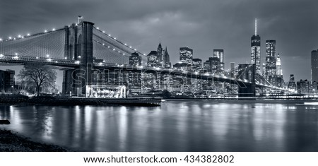 Panoramic view New York City Manhattan downtown at night with skyscrapers in blue tonality - stock photo