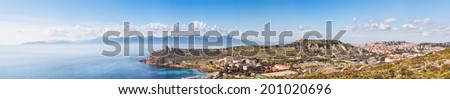Panoramic view of a coastal town with the lighthouse - stock photo