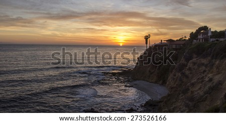Panoramic view of a Crescent Bay sunset in Spring in Laguna Beach, Southern California, United States.