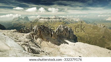 panoramic view of a mountain range in italian alps - stock photo