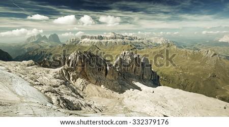panoramic view of a mountain range in italian alps - stock photo