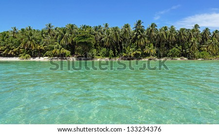 Panoramic view of a pristine island with lush tropical vegetation, Bocas del Toro, Caribbean sea, Panama - stock photo