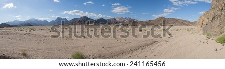 Panoramic view of a rocky desert landscape in africa with mountains - stock photo
