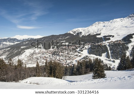 Panoramic view of a snow covered mountain range looking down valley - stock photo