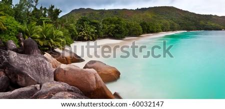 Panoramic view of a tropical beach at dawn. Anse Lazio, Praslin island, Seychelles, Indian Ocean. - stock photo
