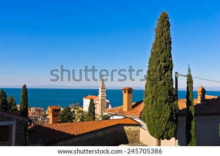 Panoramic view of adriatic sea over the roofs at city of Piran in Istria, Slovenia - stock photo