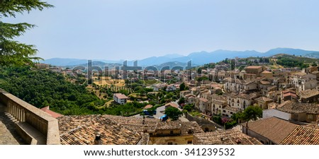 Panoramic view of Altomonte and its surroundings from Tomaso Campanella Square, Cosenza, Italy. - stock photo