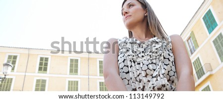 Panoramic view of an attractive businesswoman against classic buildings. - stock photo