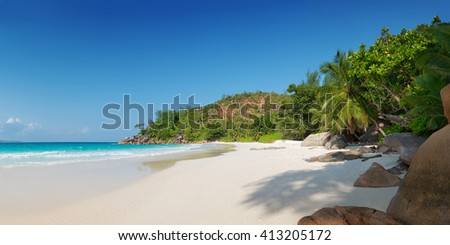 panoramic view of anse georgette beach in praslin island seychelles - stock photo