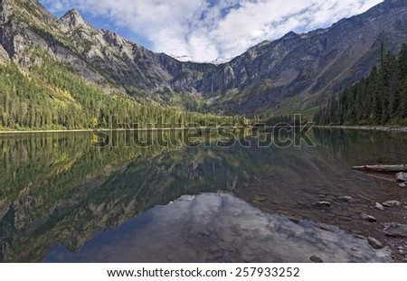 Panoramic View of Avalanche Lake and Surrounding Mountains Reflecting off Lake Surface, Glacier National Park, Montana. - stock photo