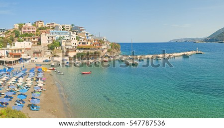 panoramic view of beach, houses and marina of small Greek town by Mediterranean sea, Bali, Crete, Greece