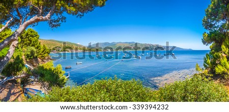 Panoramic view of beautiful coastal landscape at the Cilentan Coast with boats and wide beaches at Ogliastro Marina, province of Salerno, Campania, southern Italy - stock photo