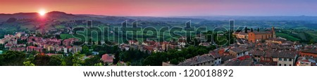 Panoramic view of beautiful landscape with the medieval city of San Gimignano at sunset in Tuscany, province of Siena, Italy - stock photo