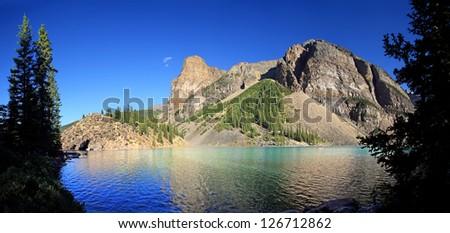 Panoramic view of Beautiful Moraine Lake, Near lake Louise, in Banff National Park, Alberta, Canada - stock photo